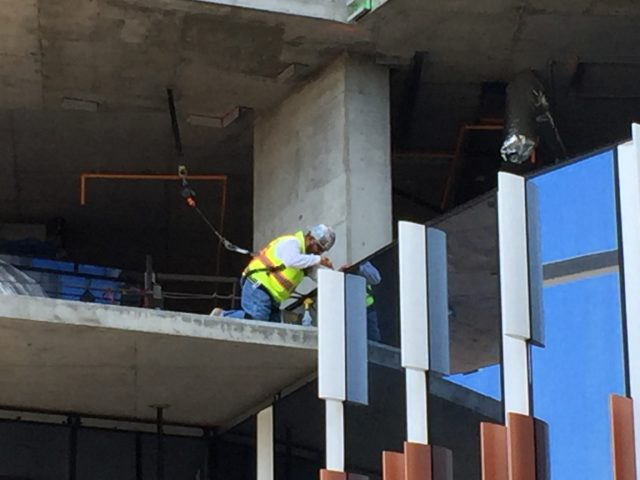 Construction worker installing exterior rib